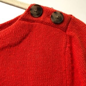 Orange sweater with button detail
